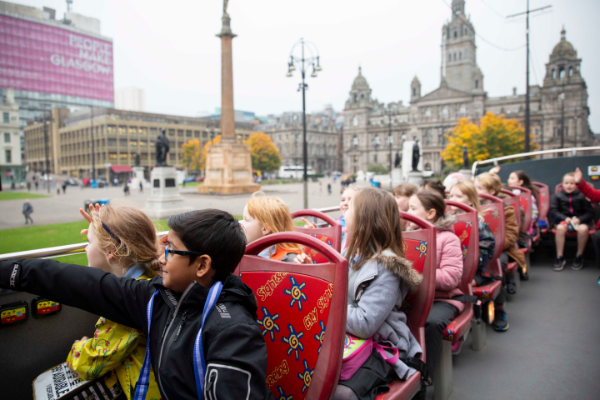 Children on top deck of City Sightseeing Glasgow bus